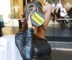 Hostess Adriana Caro adjusts her gas mask, getting ready to hand Toxies to the bad actor chemicals.