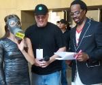 Hostess Adriana Caro, Videographer John Gannon, Emcee Cecil Corbin-Mark.