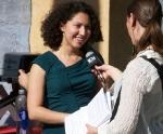 CHANGE Coordinator Christina Medina being interviewed by KPFK.